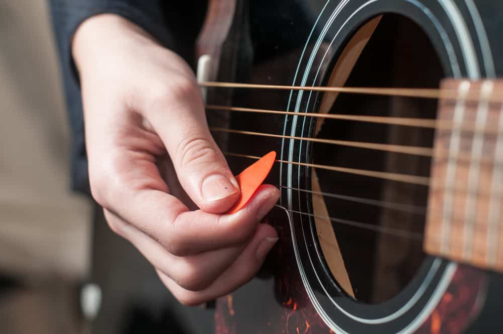Playing Acoustic Guitar With A Guitar Pick