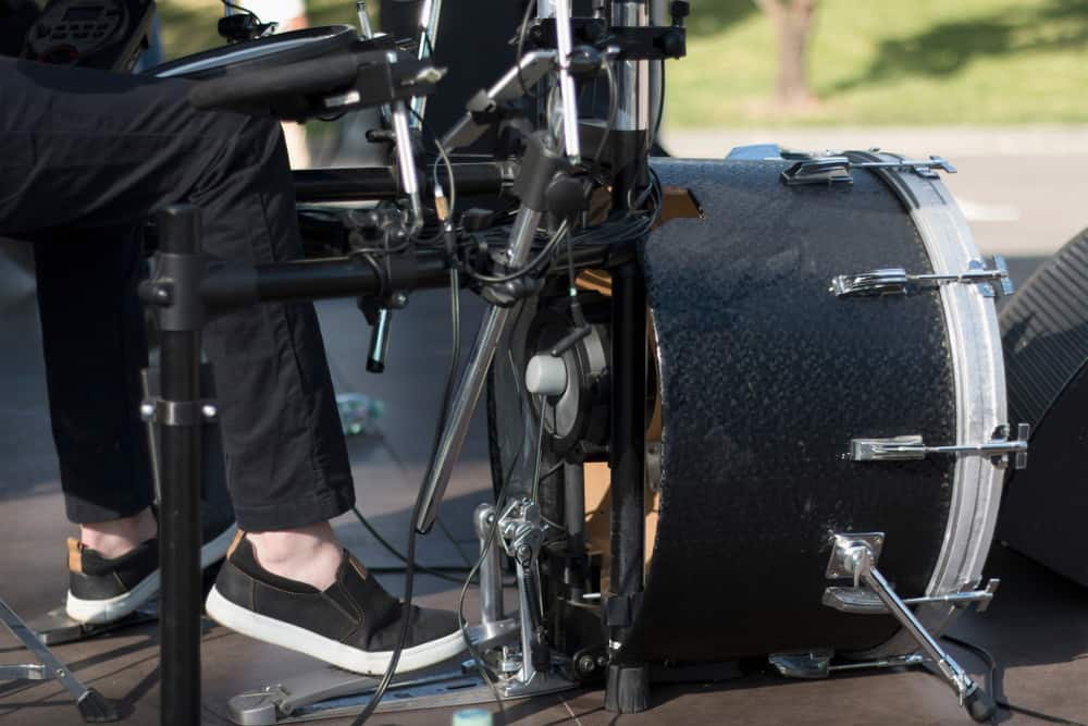 musician using kick pedals while playing music