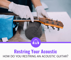 Man Learning how to Restring an Acoustic Guitar